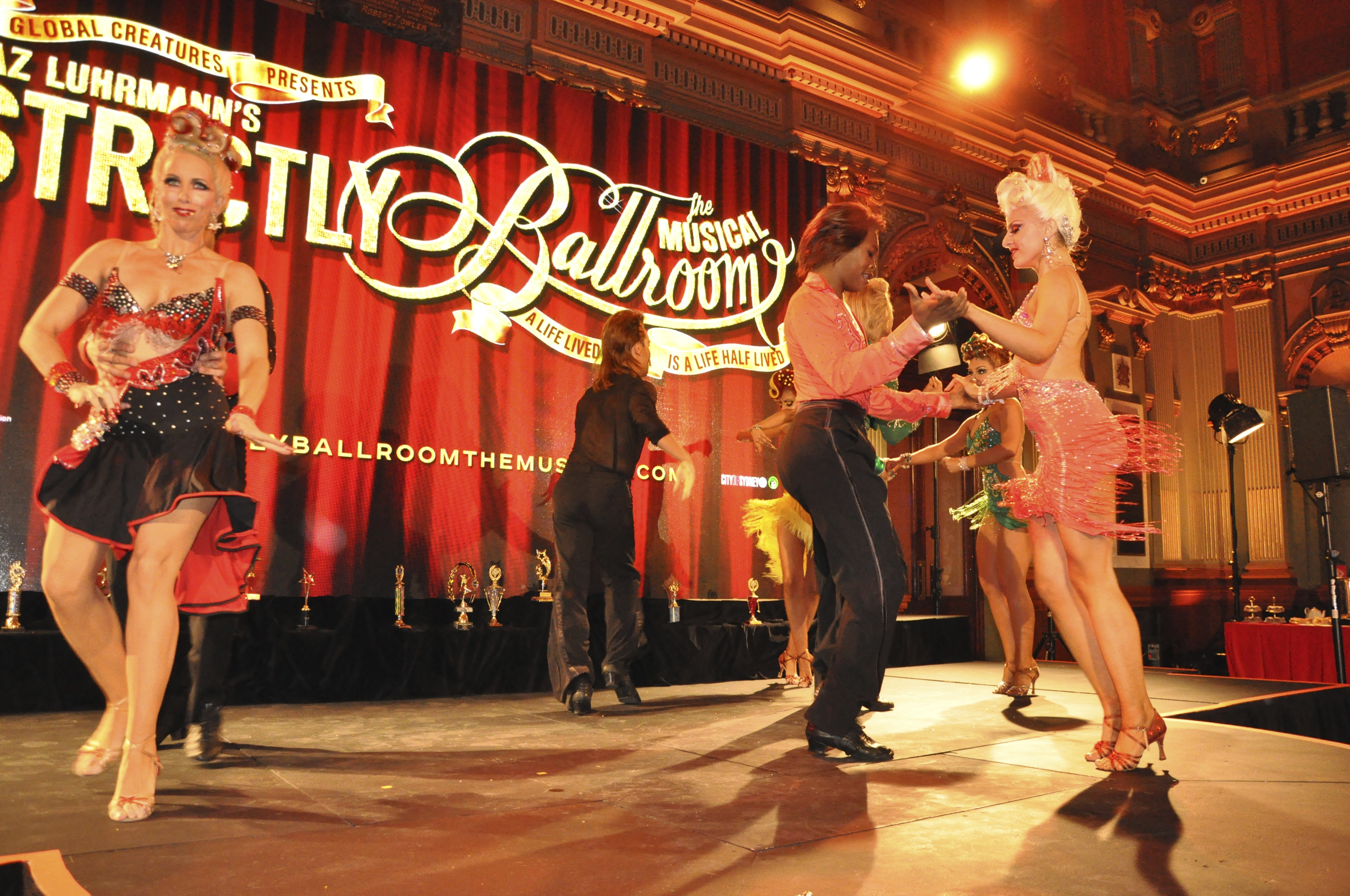 strictly ballroom Strictly ballroom, the musical – piccadilly theatre rating: sequins, feather dresses, atrocious toupees, whitened teeth, 'love is in the air' and will young in a.