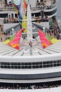Performer Vanity Faire on a Giant Stiletto as Cunard's Queen Elizabeth Salutes Sydney Mardi Gras Mandatory Credit James Morgan